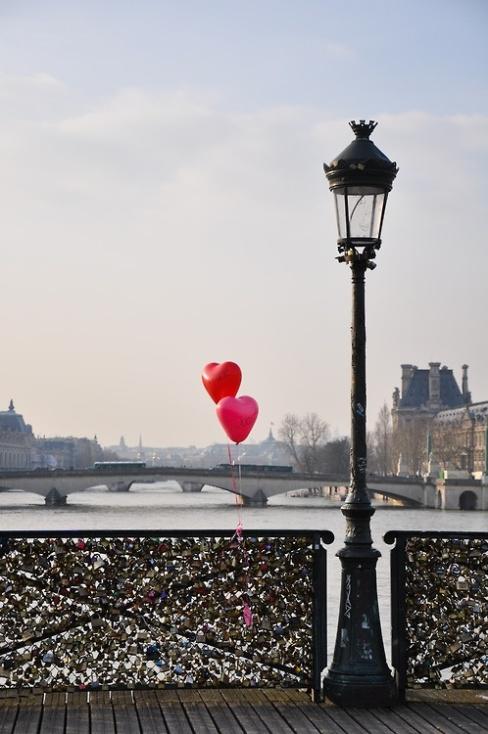 Padlocks adorn the Pont des Arts in Paris, France.